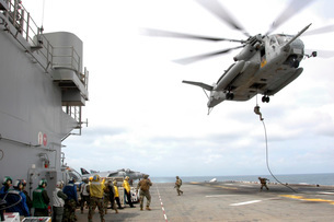Marines and sailors fast-rope from a CH-53E Super Stallion.の写真素材 [FYI02105145]