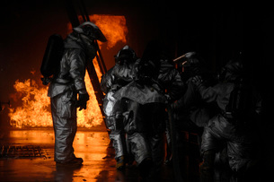 Firefighters extinguish a simulated cargo fire at RAF Mildenの写真素材 [FYI02105238]