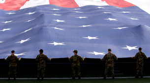 Airmen present the American Flag during the National Anthem.の写真素材 [FYI02105393]
