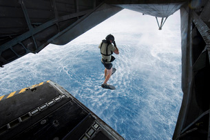 Air Force pararescueman jumps from a CH-53E Super Stallion helicopter.の写真素材 [FYI02106135]