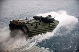 An amphibious assault vehicle departs the well deck of USS New Orleans.の写真素材 [FYI02106257]