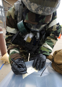 U.S. Air Force Airman writes on M8 chemical detection paper during an operational readiness exerciseの写真素材 [FYI02106556]
