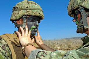 Seaman has his face painted to help camouflage him.の写真素材 [FYI02106570]