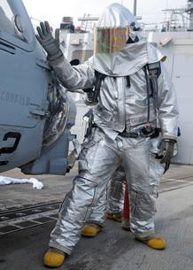 Hull Maintenance Technician checks an SH-60B Sea Hawk helicopter.の写真素材 [FYI02106583]