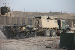 A light armored vehicle being towed at a military base in Afghanistan.の写真素材 [FYI02106645]