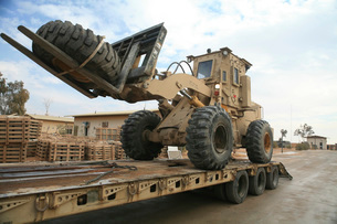forklift is unloaded off of a logistics support vehicle.の写真素材 [FYI02106745]