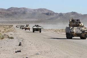 Convoy of military vehicles traveling in Fort Irwin, California.の写真素材 [FYI02106801]