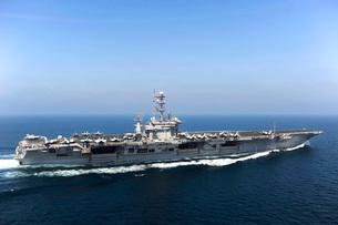 Aircraft carrier USS John C. Stennis transits the Arabian Gulf.の写真素材 [FYI02106838]