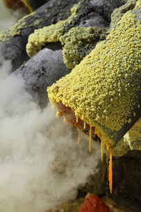 Molten sulphur trickling out of condensation pipe, Kawah Ijen volcano, Java, Indonesia.の写真素材 [FYI02106959]