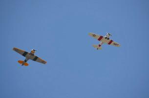 Two restored vintage warbirds in flight near Lakeland, Florida.の写真素材 [FYI02107033]