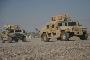 Two M1114 Humvee vehicles at Camp Taji, Iraq.の写真素材 [FYI02107091]