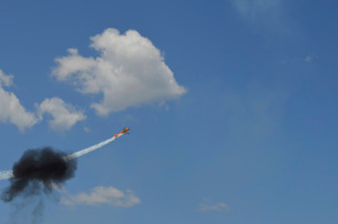 A Yakovlev Yak-55M aerobatic aircraft flys through a smoke ring.の写真素材 [FYI02107128]