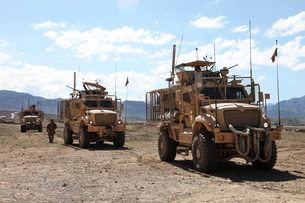 Three U.S. Army Mine Resistant Ambush Protected vehicles.の写真素材 [FYI02107270]