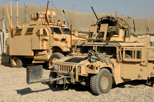A M1114 humvee sits parked in front of a MaxxPro MRAP.の写真素材 [FYI02107343]