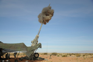 The M982 Excalibur 155mm round leaves the barrel of an M777 Howitzer.の写真素材 [FYI02107354]
