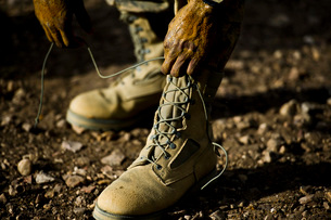 An Air Force Basic Military Training trainee reties his boots.の写真素材 [FYI02107358]