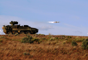 A TOW missile is launched from an armored vehicle.の写真素材 [FYI02107458]
