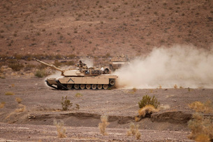 Marines roll through the Combat Center training area during a patrol.の写真素材 [FYI02107463]