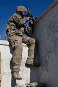 A U.S. Soldier provides security at an outpost in Afghanistan.の写真素材 [FYI02107496]