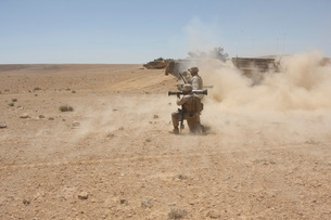 U.S. Marines fire several high-explosive rockets in the Middle East.の写真素材 [FYI02107534]