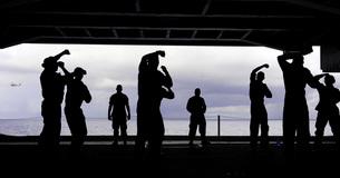 Silhouette of sailors in the hangar bay aboard USS George H.W. Bush.の写真素材 [FYI02107585]