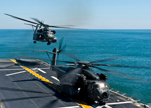 MH-53E Sea Dragon helicopters take off from the flight deck of USS Wasp.の写真素材 [FYI02107771]