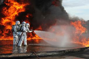 Firefighting Marines battle a huge blaze.の写真素材 [FYI02107934]