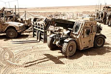 A Combat Logistics Battalion multi-mission vehicle unloads supplies.の写真素材 [FYI02108162]