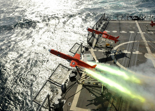 A BQM-74E aerial drone launches from the guided-missile frigate USS Thach.の写真素材 [FYI02108216]