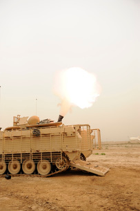 A M120 Mortar system is fired out of a M113 Armored Personal Carrier.の写真素材 [FYI02108234]