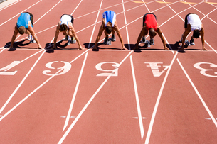 Male sprinters on starting blocks, elevated viewの写真素材 [FYI02112931]