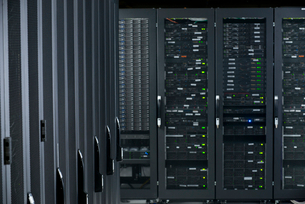 Servers in storage cabinets in data centerの写真素材 [FYI02113592]