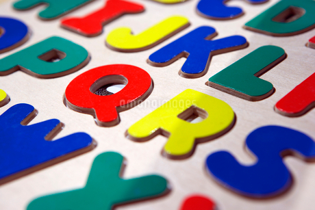 Multi-coloured capital letters of the alphabet, close-up (full frame, still life)の写真素材 [FYI02115442]