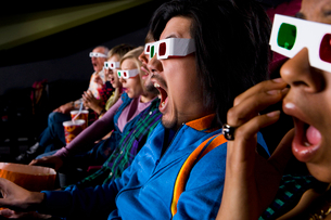 Audience in cinema wearing 3D glasses, close-upの写真素材 [FYI02115701]