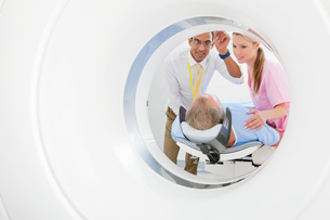 Doctor and technician nurse preparing patient at CT scanner tube in hospitalの写真素材 [FYI02115794]