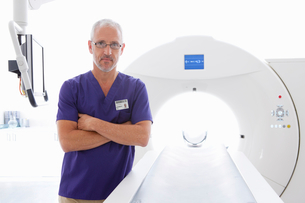 Portrait serious doctor at CT scanner in hospitalの写真素材 [FYI02115965]