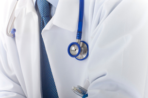 Close up of doctor's lab coat and stethoscopeの写真素材 [FYI02116388]