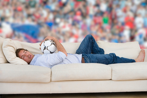 Man daydreaming about soccer matchの写真素材 [FYI02116479]