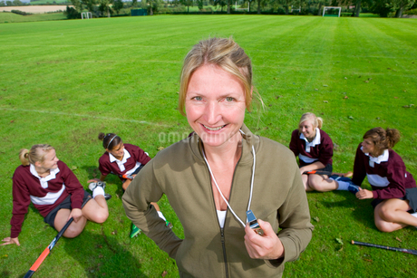 Portrait of smiling field hockey coach holding whistleの写真素材 [FYI02116561]
