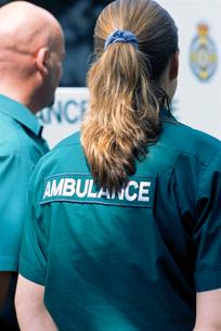 Paramedics standing outside ambulanceの写真素材 [FYI02117961]