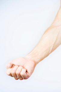 A male nude, clenched handの写真素材 [FYI02118301]