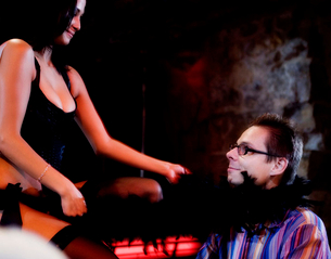 An erotic dancer teasing a clientの写真素材 [FYI02118670]