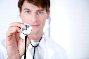 Male doctor holding a stethoscope towards the cameraの写真素材 [FYI02118879]