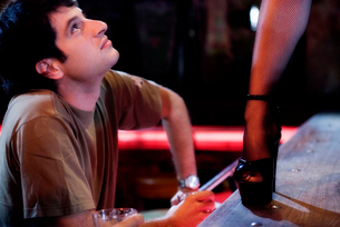 A man watching an erotic dancerの写真素材 [FYI02119206]