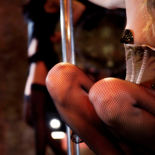Close-up of two pole dancersの写真素材 [FYI02119214]