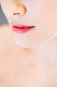 Detail of young woman's face showing mouthの写真素材 [FYI02120418]