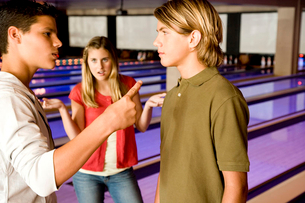 Argument between teenage boys in a bowling alleyの写真素材 [FYI02120700]