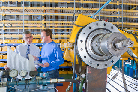 Engineers with blueprints in factoryの写真素材 [FYI02121059]