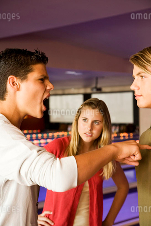 Argument between teenage boys in a bowling alleyの写真素材 [FYI02121702]