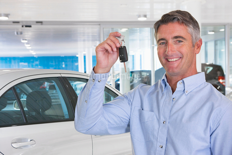 Portrait Of Man Collecting New Car From Showroomの写真素材 [FYI02122336]